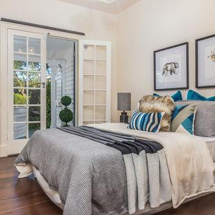 Design ideas for a transitional guest bedroom in Brisbane with beige walls, dark hardwood floors and brown floor.