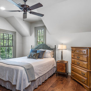 Example Of A Classic Guest Dark Wood Floor And Brown Bedroom Design In Austin With
