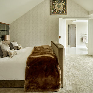 Photo of a contemporary master bedroom in London with beige walls, carpet and beige floors.
