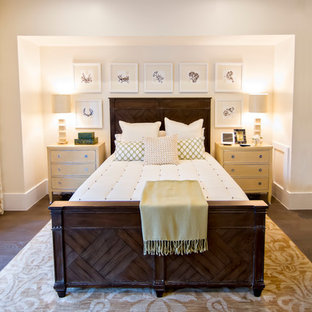 Large island style master dark wood floor and brown floor bedroom photo in Jacksonville with white walls and no fireplace