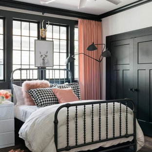 Example of a transitional dark wood floor and brown floor bedroom design in Atlanta with white walls