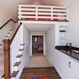 Foto de dormitorio tipo loft, exótico, grande, sin chimenea, con paredes blancas y suelo de madera oscura