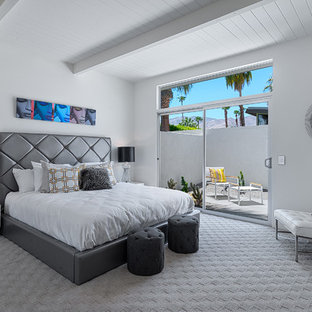 Midcentury bedroom in Los Angeles with white walls and carpet.