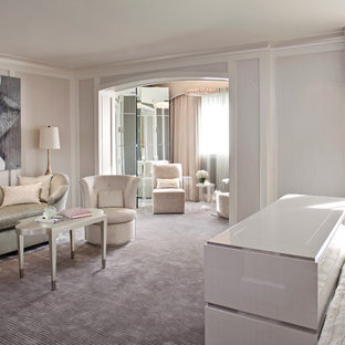Inspiration for a large contemporary master bedroom in Los Angeles with pink walls, carpet and no fireplace.