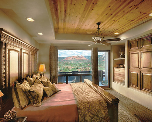 Mid Sized Rustic Master Light Wood Floor Bedroom Idea In Phoenix With Beige Walls