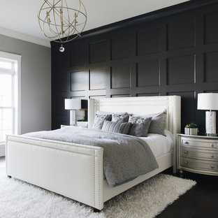Traditional bedroom in Chicago with black walls and black floors.