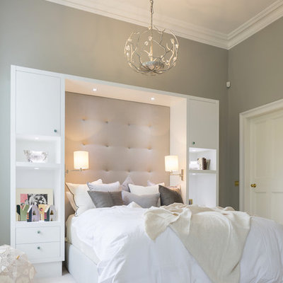 Bedroom - large transitional guest carpeted bedroom idea in London with gray walls and no fireplace