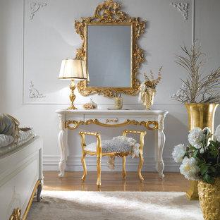 Mid-sized elegant bedroom photo in London