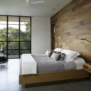 Lovely Example Of A Minimalist Concrete Floor And Gray Floor Bedroom Design In  Austin