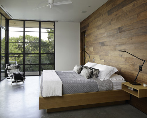 Great Example Of A Minimalist Concrete Floor And Gray Floor Bedroom Design In  Austin