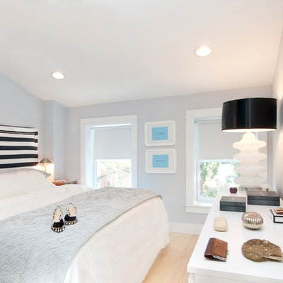Inspiration for a small contemporary master light wood floor bedroom remodel in Bridgeport with blue walls and no fireplace