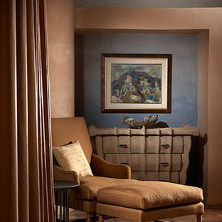 Design ideas for a large modern bedroom in New York with terra-cotta floors and blue walls.