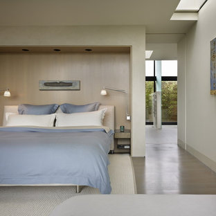 Bedroom - modern guest light wood floor bedroom idea in Seattle with white walls and no fireplace