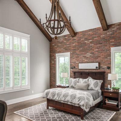 Elegant master dark wood floor bedroom photo in Nashville with gray walls