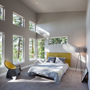 Large contemporary master bedroom in Portland with grey walls, carpet, no fireplace and grey floors.
