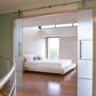 Design ideas for a contemporary bedroom in Providence with white walls.