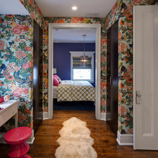 Example of a transitional medium tone wood floor bedroom design in Chicago with blue walls
