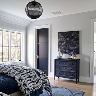 Farmhouse brown floor bedroom photo in Chicago with gray walls