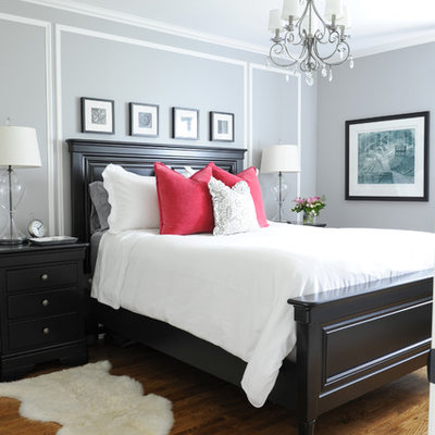 Bedroom - small traditional master medium tone wood floor bedroom idea in Vancouver with gray walls and no fireplace