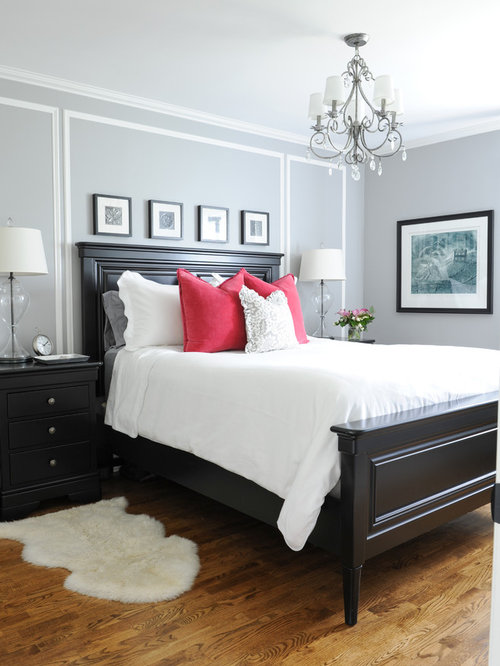 Small traditional master medium tone wood floor bedroom idea in Vancouver  with gray walls