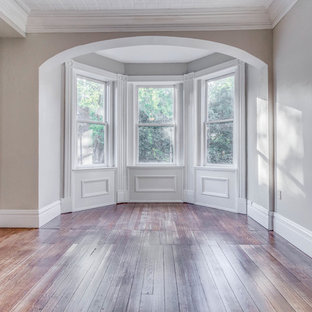 Inspiration for a large victorian loft-style bedroom in St Louis with grey walls, dark hardwood floors and blue floor.