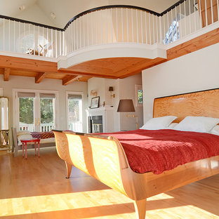 Photo of a traditional loft-style bedroom in Seattle with beige walls and medium hardwood floors.