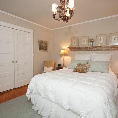 Example of a classic bedroom design in Wilmington with beige walls