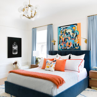 Inspiration for a classic master bedroom in San Francisco with white walls and medium hardwood flooring.