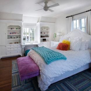 Example of a classic dark wood floor bedroom design in Phoenix with white walls