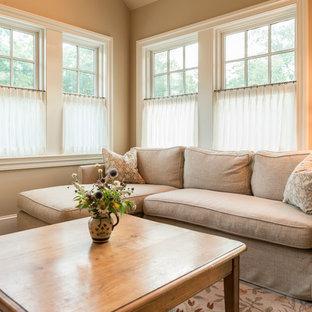 Imagen de dormitorio tipo loft, bohemio, grande, sin chimenea, con paredes beige, suelo de madera oscura y suelo multicolor