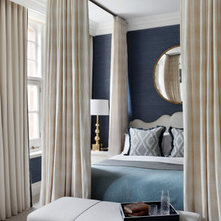 This is an example of a large classic master bedroom in London with blue walls, carpet and grey floors.