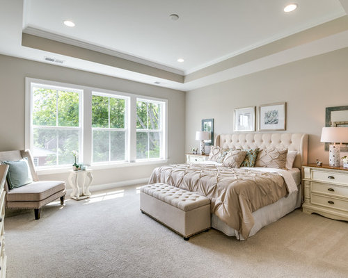 example of a classic carpeted and beige floor bedroom design in dc metro with beige walls