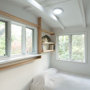 Inspiration for a mid-sized scandinavian loft-style bedroom in Chicago with white walls, marble floors and no fireplace.