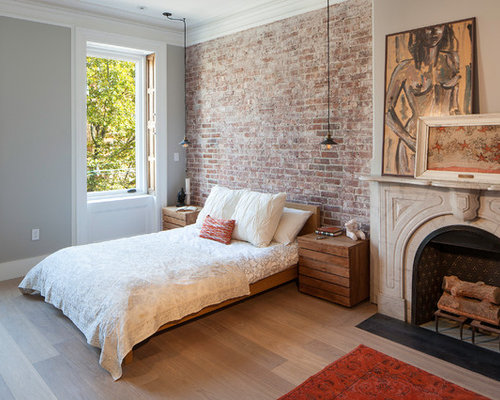Brick Wall Design exposed brick wall decorating ideas brick wall designs Example Of A Transitional Master Bedroom Design In New York With Gray Walls Light Hardwood
