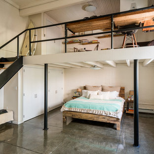 Large eclectic master concrete floor and gray floor bedroom photo in New York with white walls and no fireplace