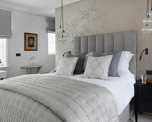 example of a transitional master carpeted bedroom design in london with gray walls