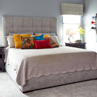 Bedroom - large transitional master carpeted bedroom idea in Other with gray walls