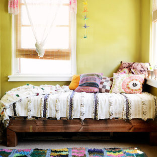 Mid-sized eclectic guest carpeted bedroom photo in Sydney with yellow walls