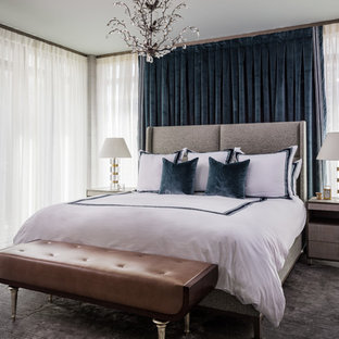 Design ideas for a large transitional master bedroom in Miami with blue walls, porcelain floors, grey floor and no fireplace.