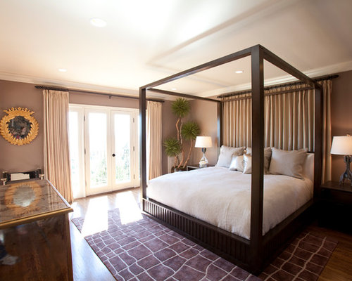 Delightful Inspiration For A Transitional Medium Tone Wood Floor Bedroom Remodel In  Los Angeles With Brown Walls