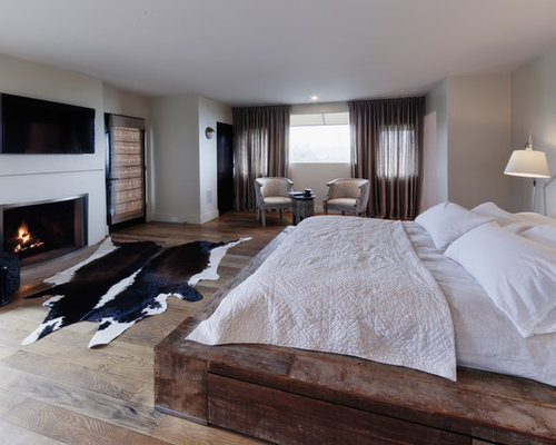 Inspiration for a rustic master light wood floor bedroom remodel in Los  Angeles with gray walls