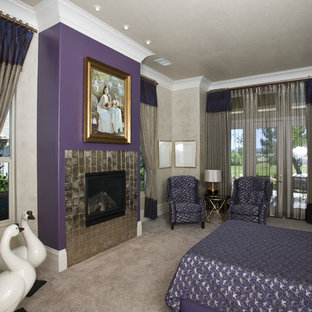 Large trendy master carpeted and beige floor bedroom photo in Sacramento with a tile fireplace, beige walls and a standard fireplace