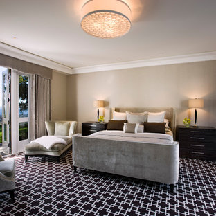 Design ideas for a transitional bedroom in Santa Barbara with beige walls and carpet.