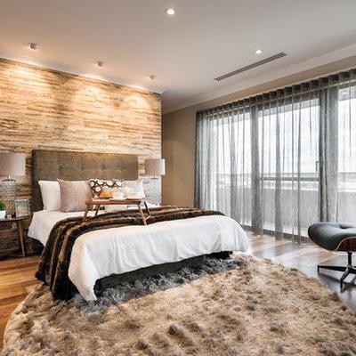 Trendy master medium tone wood floor bedroom photo in Perth with gray walls
