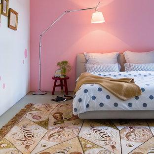 Diseño de dormitorio contemporáneo con paredes rosas, suelo de cemento y suelo gris
