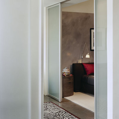 Inspiration for a modern concrete floor bedroom remodel in Boston with gray walls