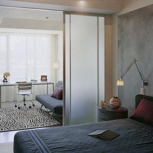 Immagine di una camera da letto moderna con pareti grigie