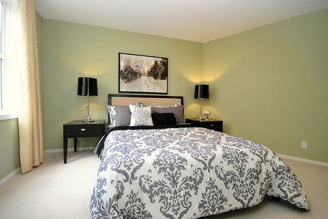 Contemporary Bedroom by Revealing Assets - Home Staging Services
