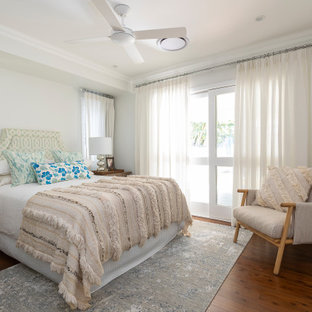 This is an example of a mid-sized transitional master bedroom in Brisbane with grey walls and brown floor.