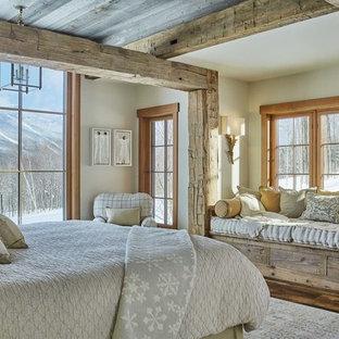 Mountain style medium tone wood floor and brown floor bedroom photo in Burlington with white walls